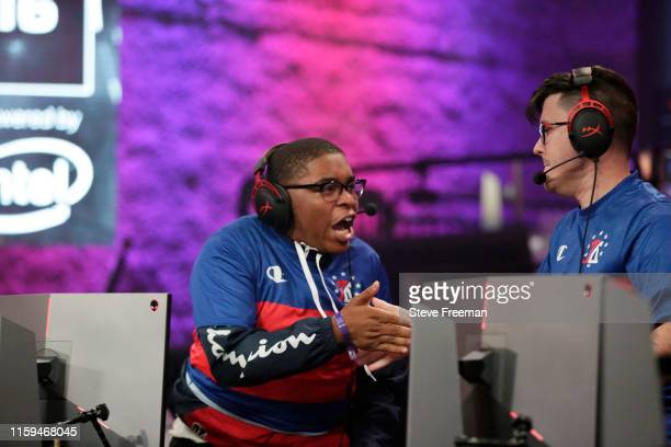 ZDS hi fives Newdini33 of 76ers Gaming Club during Game Four of the NBA 2K League Finals on August 3 2019 at the NBA 2K Studio in Long Island City...
