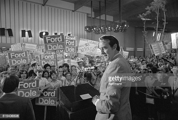 Robert Dole smiles to the cheers of a shopping center crowd before making a brief speech The Republican nominee for vice president is campaigning in...