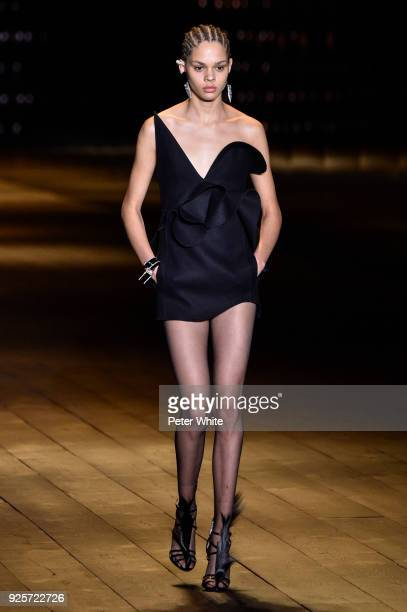 Hiandra Martinez walks the runway during the Saint Laurent show as part of the Paris Fashion Week Womenswear Fall/Winter 2018/2019 on February 27...