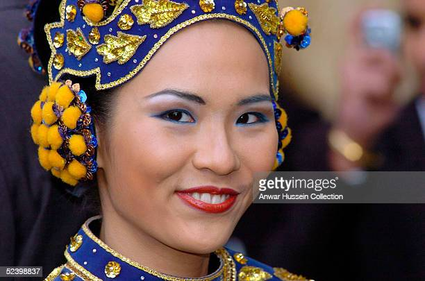 HianPing from Kuala Lumpur in Malaysia arrives for an Observance for Commonwealth Day 2005 service held at Westminster Abbey in central London on...