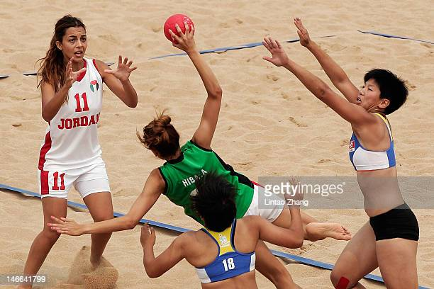 Hiba Alaof Jordan is challenged by Sin Man Ng of Hong Kong China during the Beach Handball Women's Team Finals Match for 7/8 on Day 5 of the 3rd...