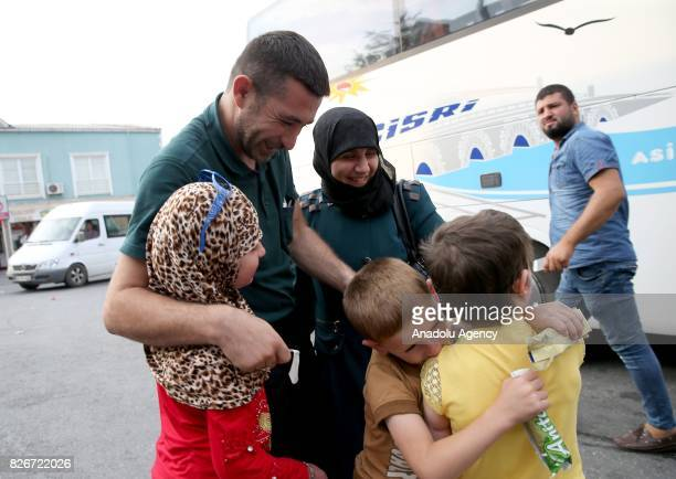 Hiba Mekzum 8yearold meets with her mother Diyya Kadik her father Muhammed Mekzum her brother Faysal and her sister Merva after receiving 8 months of...