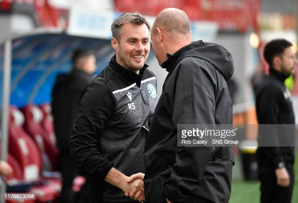 Hibernian assistant Robbie Stockdale shakes hands with Hamilton manager Brian Rice ahead of the Ladbrokes Premiership match between Hamilton and...