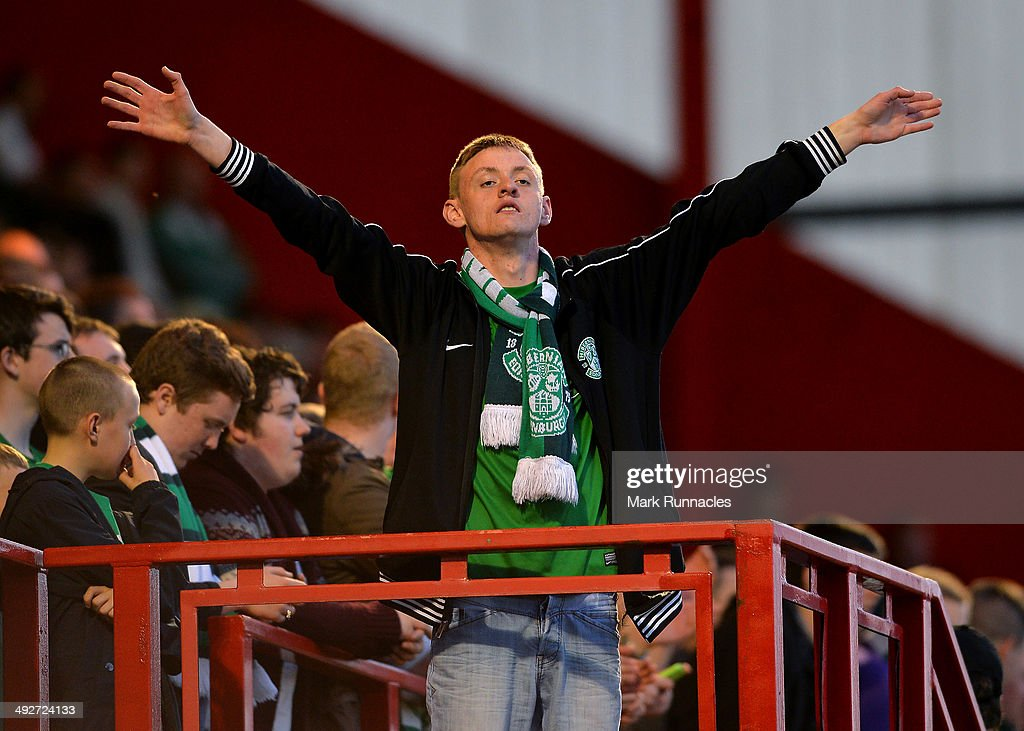 A Hibernian fan celebrates his teams 2-0 victory over Hamilton Academical during the Scottish Premiership Play-off Final First Leg, between Hamilton Academical and Hibernian at New Douglas Park on May 21, 2014 in Hamilton Scotland.