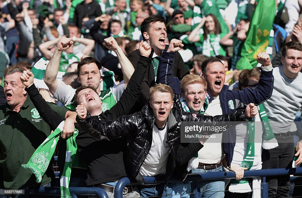 Hibernian fans celebrate at the final whistle as Hibernian beat Rangers 3-2 during the William Hill Scottish Cup Final between Rangers FC and Hibernian FC at Hamden Park on May 21, 2016 in Glasgow, Scotland.