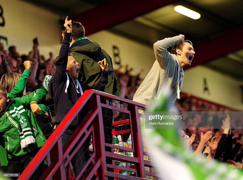 Hibernian fans celebrate their teams 2-0 victory over Hamilton Academical during the Scottish Premiership Play-off Final First Leg, between Hamilton Academical and Hibernian at New Douglas Park on May 21, 2014 in Hamilton Scotland.
