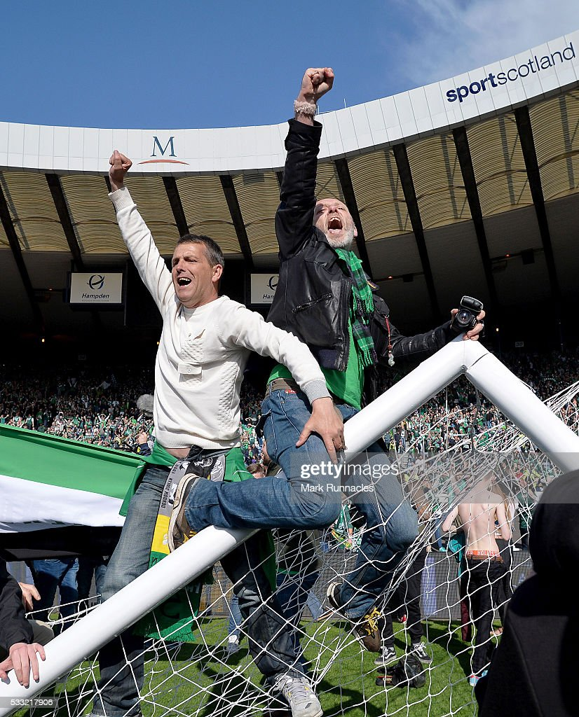 Hibernian fans invade the Hampden Park pitch at the final whistle as Hibernian beat Rangers 3-2 during the William Hill Scottish Cup Final between Rangers FC and Hibernian FC at Hamden Park on May 21, 2016 in Glasgow, Scotland.