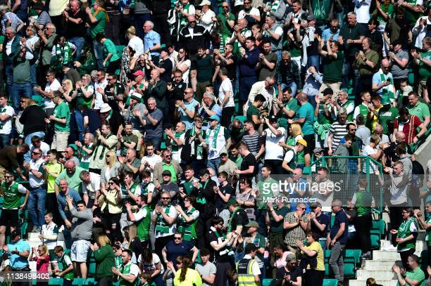 Hibernian fans look on in the sunshine during the Ladbrokes Premiership match between Hibernian and Celtic at Easter Road on April 21 2019 in...