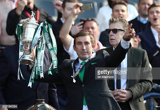 Hibernian Manager Alan Stubbs lifts the cup during the Scottish Cup Final between Rangers and Hibernian at Hampden Park on May 21 2016 in Glasgow...