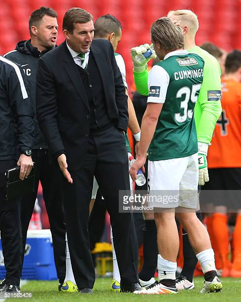 Hibernian Manager Alan Stubbs talks to Jason Cummings of Hibernian prior to the penalty shoot out during the Scottish Cup Semi Final between...