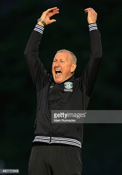 Hibernian manager Terry Butcher celebrates after his team beat Hamilton Academical 20 during the Scottish Premiership Playoff Final First Leg between...