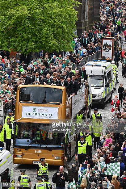 Hibernian players stand on an open top bus as they stage a victory parade to celebrate yesterdays historic Scottish Cup final win over Rangers on May...