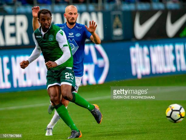 Hibernian 's Nigerian midfielder Ambrose Efe vies for the ball with Molde's Norwegian midfielder Eirik Hestad during the UEFA Champions League third...