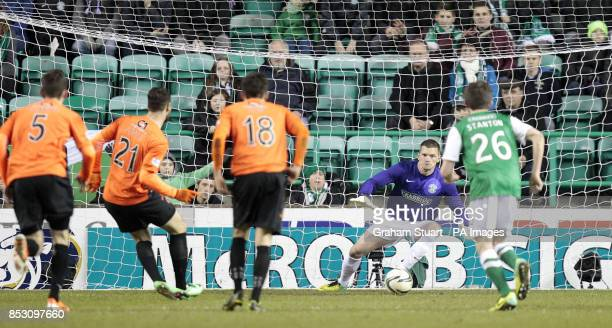 Hibernian's Ben Williams saves a penalty against Dundee United's Nadir Ciftci during the Scottish Premier League match at Easter Road Edinburgh
