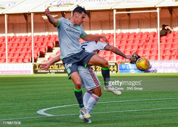 Hibernians Joe Newell claims for a penalty after being tackled by Scott Martin during the Ladbrokes Premiership match between Hamilton and Hibernian...