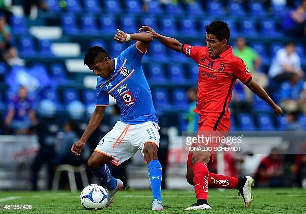 Hibert Ruiz of Morelia vies for the ball with Joao Rojas of Cruz Azul during their Mexican Apertura tournament football match at the Azul stadium on...