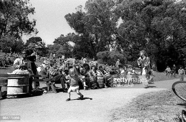 Hibiscus of the Cockettes an American theatre group dances with a baby on Hippie Hill at Golden Gate Park on April 20 1969 in San Francisco California