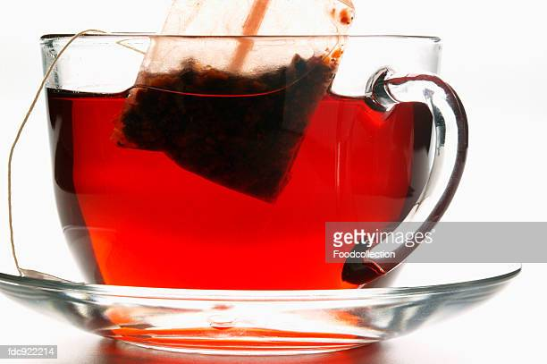 Hibiscus tea in glass cup with tea bag