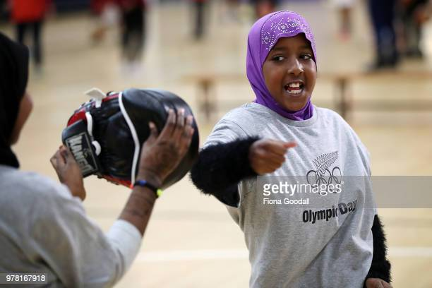 Students play football during the Olympic Refugee Sport Day at The Trusts Arena on June 19 2018 in Auckland New Zealand The event saw refugees aged...