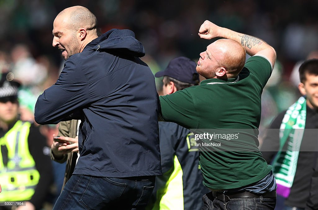 Hibs and Rangers fans fight after they invade the pitch during the Scottish Cup Final between Rangers and Hibernian at Hampden Park on May 21, 2016 in Glasgow, Scotland.
