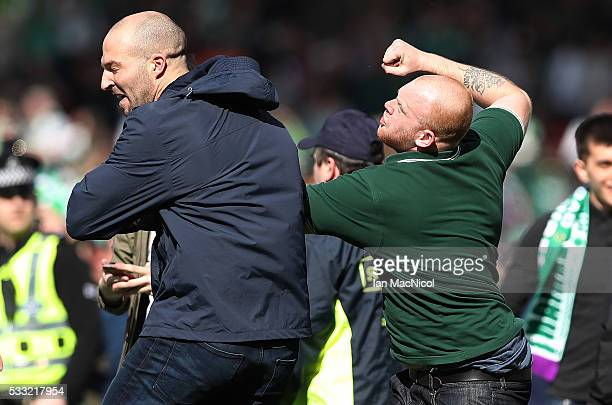 Hibs and Rangers fans fight after they invade the pitch during the Scottish Cup Final between Rangers and Hibernian at Hampden Park on May 21 2016 in...