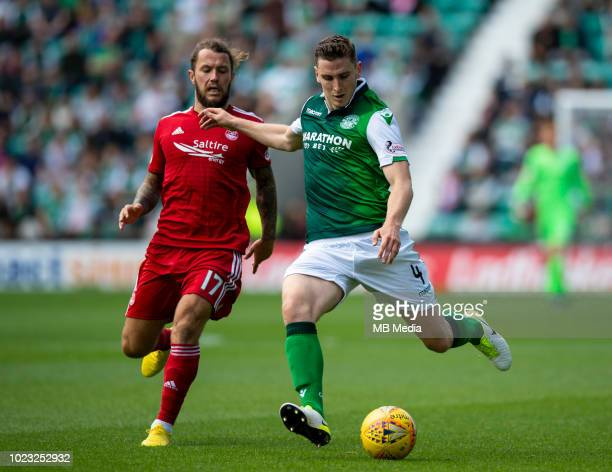 Hibs' defender Paul Hanlongets away from Aberdeen striker Stevie May during the first half as Hibernian play host to Aberdeen at Easter Road on...