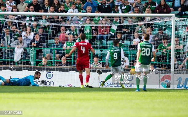 Hibs' forward Jamie MacLaren pokes the ball home to score his sides equaliser 4 minutes from time as Hibernian play host to Aberdeen at Easter Road...