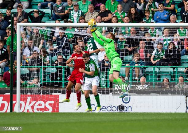 Hibs goalkeeper Adam Bogdan gathers the ball during the first half as Hibernian play host to Aberdeen at Easter Road on August 25 2018 in Edinburgh...