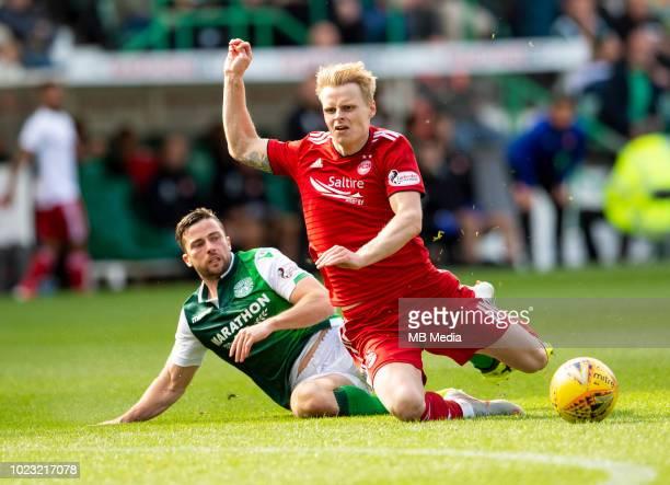 Hibs' midfielder Lewis Stevenson fouls Aberdeen midfielder Gary MacKaySteven during the second half as Hibernian play host to Aberdeen at Easter Road...