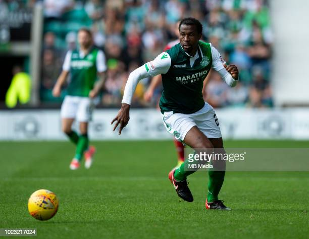 Hibs' Nigerian defender Efe Ambrose gather the ball during the second half as Hibernian play host to Aberdeen at Easter Road on August 25 2018 in...