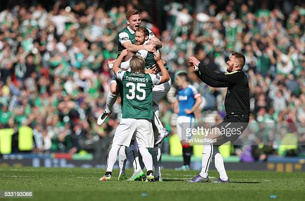 Hibs players celebrate at full time during the Scottish Cup Final between Rangers and Hibernian at Hampden Park on May 21 2016 in Glasgow Scotland