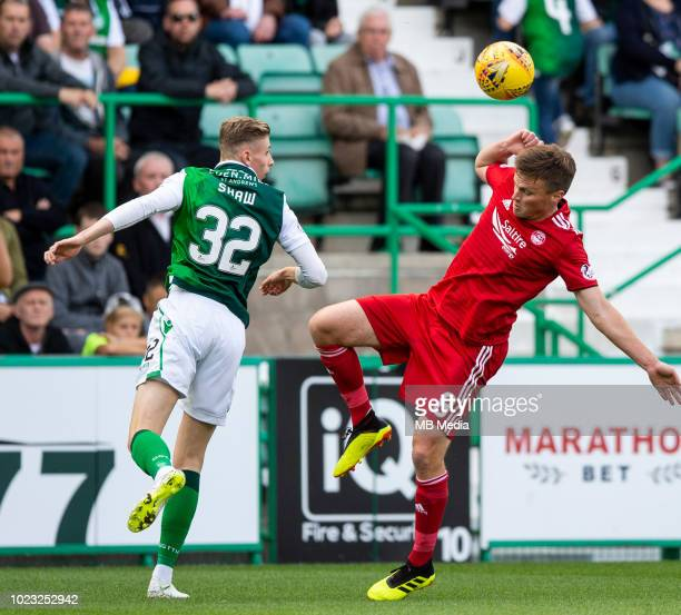 Hibs' striker Oli Shaw beats Aberdeen midfielder Stephen Gleeson to the ball during the second half as Hibernian play host to Aberdeen at Easter Road...