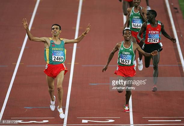 Hicham El Guerrouj of Morocco celebrates as he crosses the finish line and win's the men's 5000 metre final on August 28 2004 during the Athens 2004...