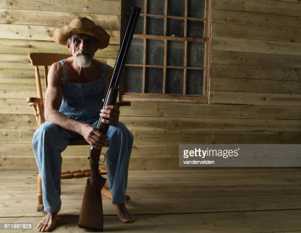 hick in bib overalls and straw hat - hillbilly stock pictures, royalty-free photos & images