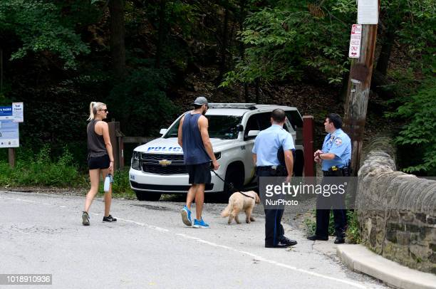 Hickers are informed by police officers of the closure of Devils Pool in the Wissahickon Valley in Philadelphia PA on August 18 2018 Locals find the...