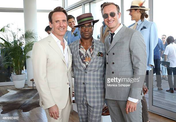 Hickey Freeman designer Arnold Brant Silverstone poses for a photo with Broadway actor Billy Porter and Adam Smith at the Hickey Freeman presentation...