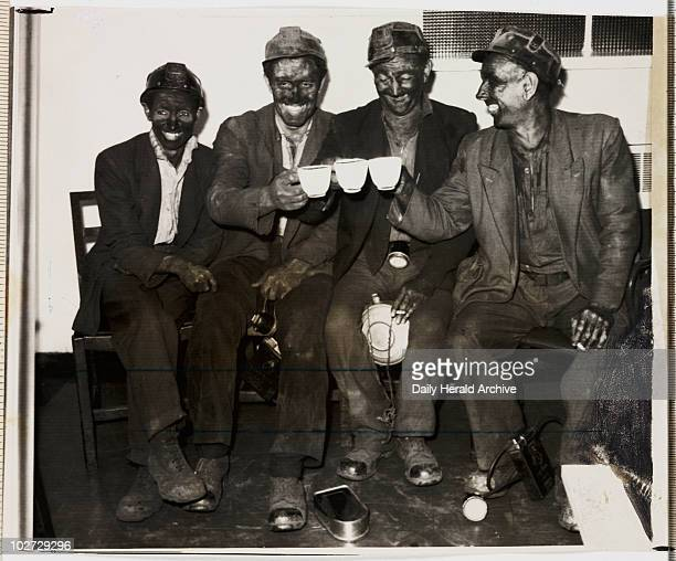 Hickleton Main Colliery 1960 A photograph of four coal miners from Hickleton Main Colliery South Yorkshire toasting themselves with cups of tea taken...
