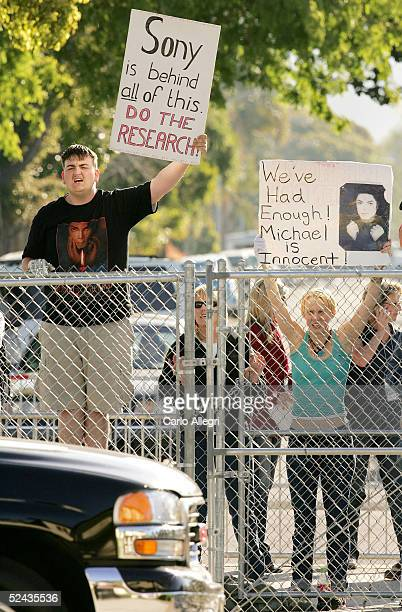 J Hickman a Michael Jackson supporter yells as the sport utility vehicle transporting Jackson arrives at Santa Maria Superior Court before testimony...