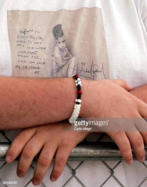 J Hickman stands waiting to support singer Michael Jackson before he arrives at the Santa Maria Superior Court for testimony during the third week of...