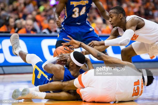 Hicks of the Morehead State Eagles battles for a loose ball with Paschal Chukwu and Jalen Carey of the Syracuse Orange during the first half at the...