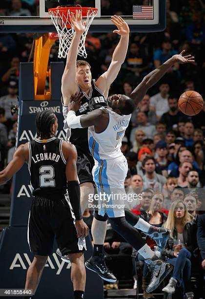 J Hickson of the Denver Nuggets goes up for a shot and is fouled by Aron Baynes of the San Antonio Spurs as Kawhi Leonard of the San Antonio Spurs...