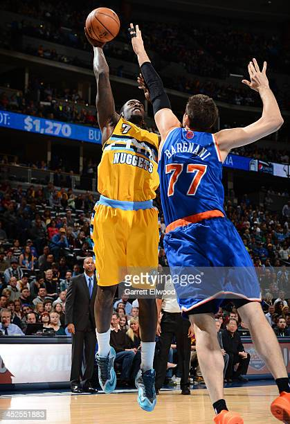 J Hickson of the Denver Nuggets shoots against Andrea Bargnani of the New York Knicks on November 29 2013 at the Pepsi Center in Denver Colorado NOTE...