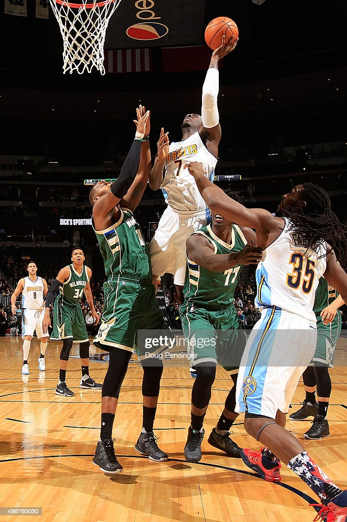 J.J. Hickson #7 of the Denver Nuggets takes a shot against Greg Monroe #15 and Johnny O'Bryant III #77 of the Milwaukee Bucks as Kenneth Faried #35 of the Denver Nuggets follows the play at Pepsi Center on November 11, 2015 in Denver, Colorado. The Nuggets defeated the Bucks 103-102.