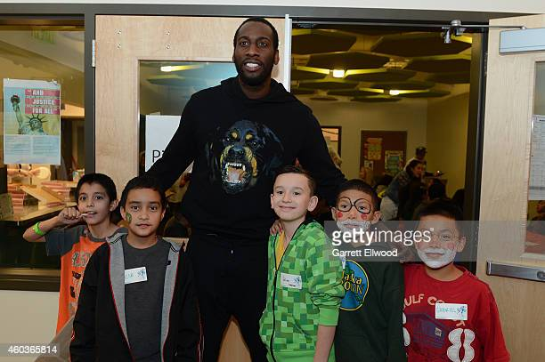 Hickson of the Denver Nuggets visits kids and poses for a photo at the Vickers Boys Girls Club during the NBA Season of Giving on December 11 2014 in...