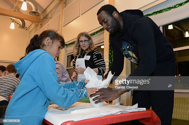 Hickson of the Denver Nuggets visits kids and wrap gifts at the Vickers Boys Girls Club during the NBA Season of Giving on December 11 2014 in Denver...