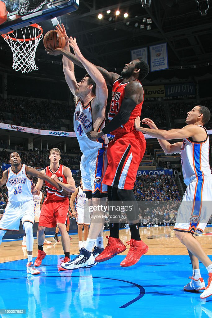 J.J. Hickson #21 of the Portland Trail Blazers blocks the shot of Nick Collison #4 of the Oklahoma City Thunder on March 24, 2013 at the Chesapeake Energy Arena in Oklahoma City, Oklahoma.
