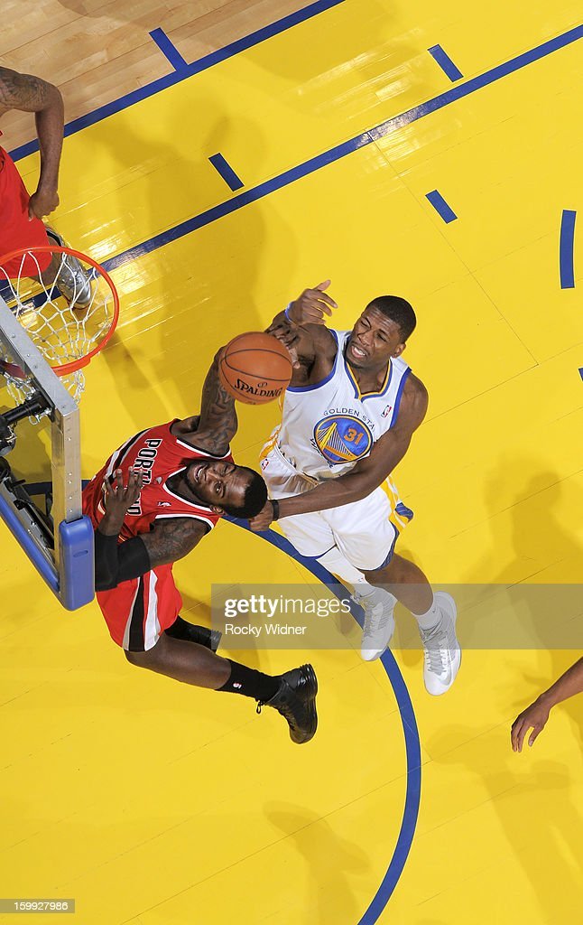 J.J. Hickson #21 of the Portland Trail Blazers shoots against Festus Ezeli #31 of the Golden State Warriors on January 11, 2013 at Oracle Arena in Oakland, California.