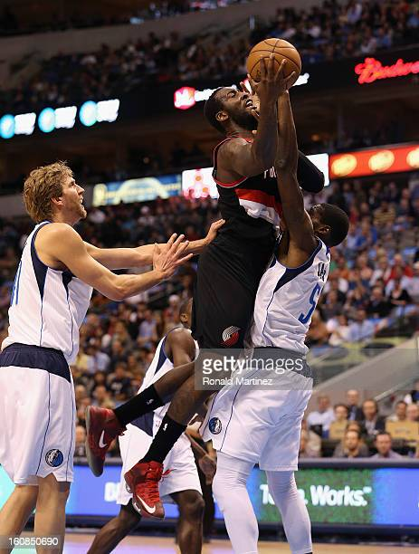 J Hickson of the Portland Trail Blazers takes a shot against Bernard James of the Dallas Mavericks at American Airlines Center on February 6 2013 in...