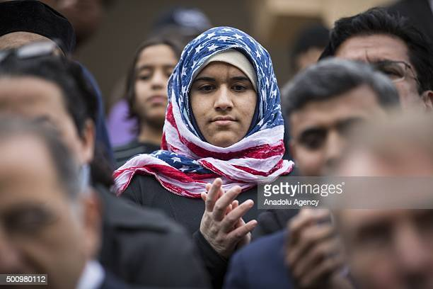 Hidayah Martinez Jaka a young Venture Scout wearing an American flag hijab is seen as US Democratic presidential candidate Martin O'Malley speaks...