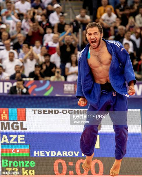 Hidayat Heydarov of Azerbaijan screams with joy and happily bouces around the mat after winning the u73kg bronze medal in front of his home audience...